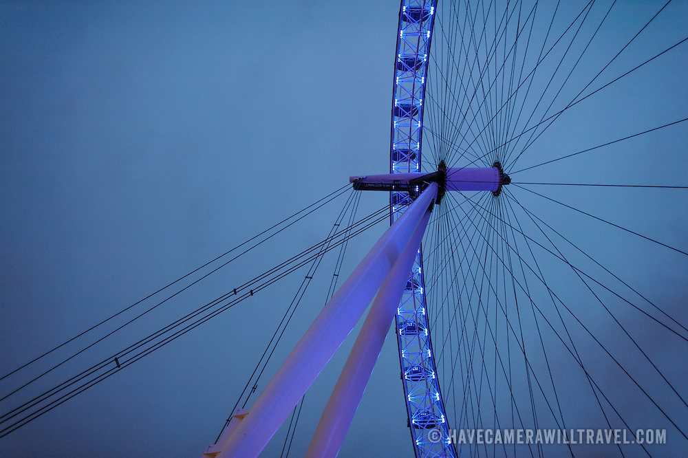 The supports holding up the London Eye (formerly known as the Millenium Wheel) at dusk against an overcast sky. Includes copyspace.