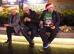 © Licensed to London News Pictures. 16/12/2016. LONDON, UK. Partygoers enjoy a night out in central London on Mad Friday, the last Friday before Christmas in the UK, which marks the start of the festive party season as many offices close for the holidays.  Photo credit: ISABEL INFANTES/LNP