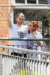 © Licensed to London News Pictures . 22/05/2018 . Manchester , UK . A man and a woman wearing bee t-shirts hug during a national minute's silence at 2:30pm , outside Manchester Cathedral , as a Service of Remembrance on the first anniversary of the Manchester Arena bombing takes place . On the evening of 22nd May 2017 , Salman Abedi murdered 22 people and seriously injured dozens more , when he exploded a bomb in the  foyer of the Manchester Arena as concert-goers were leaving an Ariana Grande gig . Photo credit : Joel Goodman/LNP