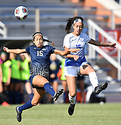 George Washington midfielder Maria Pareja (left) and St. Louis University midfielder Anna Lawler leap for the ball. St. Louis University defeated George Washington in the championship game of the Atlantic 10 Conference Women's Soccer Tournament at Robert Hermann Stadium at St. Louis University on Sunday November 10, 2019.<br /> Photon by Tim Vizer