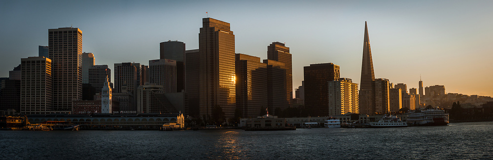 Downtown San Francisco is seen at sunset aboard a ferry departing from the ferry building to Sausalito in Marin County.