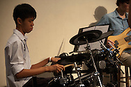 Drummer Jonathan Tan of the worship team leading the Evangelical Church of Bangkok (ECB) during the Easter service on 24 April 2011 in Bangkok, Thailand