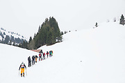 A splitboarding group skin up the Vallée De La Manche in Morzine / Portes du Soleil ski area on 21st March 2017 in France