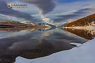 Mountain peaks reflect in Lake McDonald in winter in Glacier National Park, Montana, USA