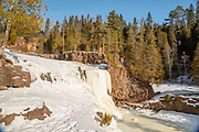 Frozen Gooseberry Falls on a cold January day; Gooseberry Falls State Park, Two Harbors, Minnesota, USA