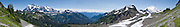 Mt. Shuksan (left, 9127 feet elevation, in North Cascades National Park) and Mount Baker (right 10,781 feet elevation) are seen from the Chain Lakes Loop Trail here in Mount Baker Wilderness, in the North Cascades mountains of Washington. The panorama was stitched from 9 overlapping photos.