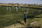 Children play little league baseball in Bakersfield. One in five children in the area have asthma, the leading cause of absenteeism in Bakersfield City Schools.