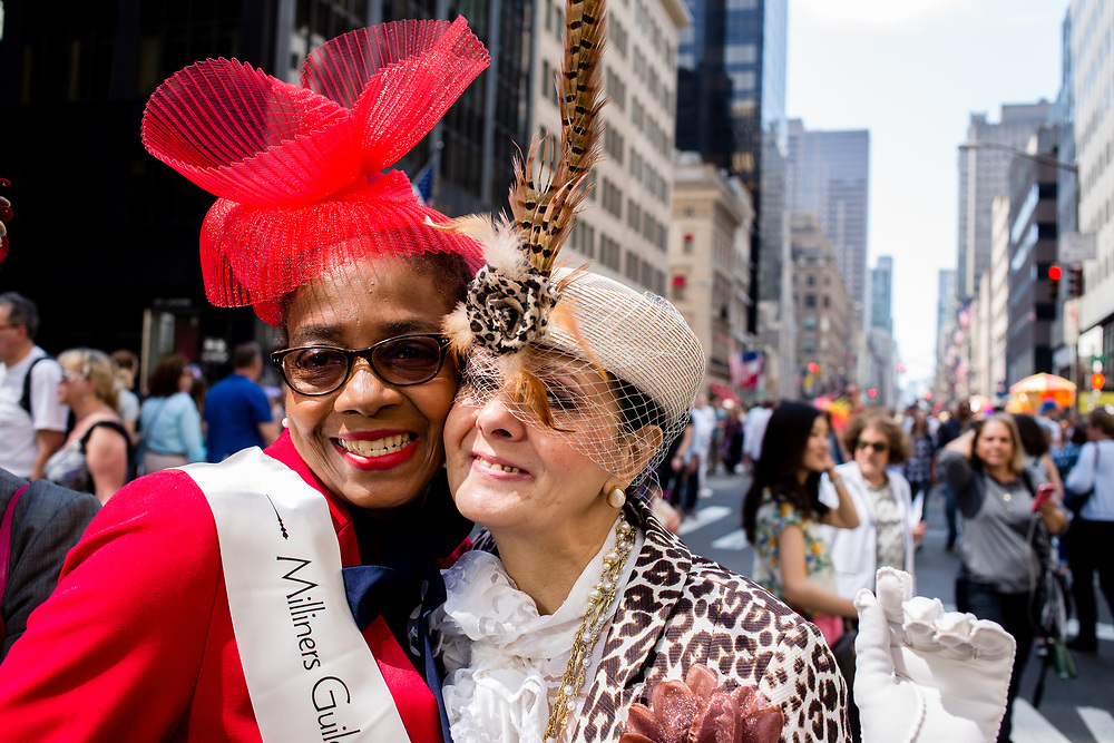 New York, NY - April 16, 2017. Wanda J. Chambers (left) and Patricia Ann Parenti of The Milliners Guild at New York's annual Easter Bonnet Parade and Festival on Fifth Avenue. Parenti is a glover.