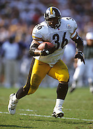 BALTIMORE, MD-UNDATED:  NFL running back Jerome Bettis of the Pittsburgh Steelers runs with the ball during a game against the Baltimore Ravens in Baltimore, Maryland.   Bettis played for the Steelers from 1996-2005.  (Photo by Ron Vesely)