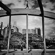 Caracas - Venezuela. A young boy walks over a bridge that connects Caracas south east with downtown. One of our main problems is our inability to put ourself some limits while enjoying our freedom and respect other people's rights.