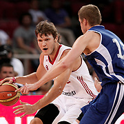 Turkey's Baris Hersek (L) and Finland's during their Adidas Istanbul Cup 2012 Final basketball match Turkey between Finland at the Abdi ipekci Arena in Istanbul Turkey on Thursday 02 August 2012. Photo by TURKPIX