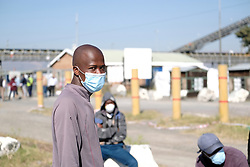 RUSTENBURG SOUTH AFRICA - MAY 18: Young men formed part of a group of protesters from the Seraleng mining community on May 18, 2020, in Rustenburg, South Africa. Seraleng residents gathered at Sibanye k5 mine shaft Communities in the area alleged complaints of food parcel corruption by a local ward councillor. Grievances also included concerns with unemployment, loss of business and access to a social labour plan. (Photo by Gallo Images/Dino Lloyd)