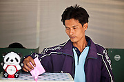 03 JULY 2011 - SAMUT PRAKAN, THAILAND:    A man drops his ballot into the ballot box in Samut Prakan, Thailand, Sunday, July 3. More than 47,000,000 Thais were registered to vote in Sunday's election, which had turned into a referendum on the current government, led, by the Thai Democrats and the oppositionPheu Thai party. Pheu Thai is the latest political incarnation of ousted Thai Prime Minister Thaksin Shinawatra. PT is led by his youngest sister, Yingluck Shinawatra, who is the party's candidate for Prime Minister. Exit polling by three Thai polling firms showed Pheu Thai winning a landslide election.    PHOTO BY JACK KURTZ