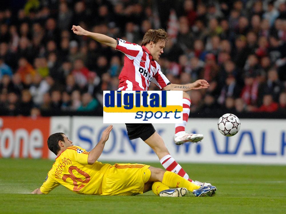 Photo: RIchard Lane.<br />PSV Eindhoven v Liverpool. UEFA Champions League, Quarter Final, 1st Leg. 03/04/2007. <br />PSV's Mika Vayrynen is tackled by Liverpool's Javier Mascherano.
