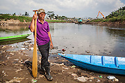 Portrait of Abah Dayat (61), who is a former fisherman but now he collects scrap from the Citarum River since the number of fish had significantly declined due to pollution.  Citeureup Village, Kabupaten Bandung...Credit: Andri Tambunan for Greenpeace
