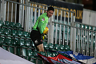 Christy Pym, the Exeter city goalkeeper has to retrieve the ball from the empty stand late in the game as the Newport county ballboys do a spot of time wasting. EFL Skybet football league two match, Newport county v Exeter City  at Rodney Parade in Newport, South Wales on New Years Day, Monday 1st January 2018.<br /> pic by Andrew Orchard,  Andrew Orchard sports photography.