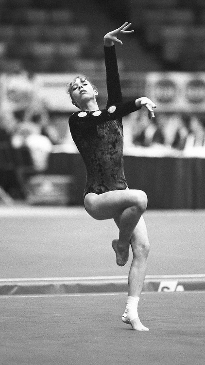 (Ottawa, Canada---16 May 1997)  competes on the floor exercise at the 1997 Canadian Gymnastics Championships. Sean Burges / Mundo Sport Images, 1997. www.mundosportimages.com ***** NOTE: Contact us if you wish to order this photo. We will clean it before sale to remove spots *****