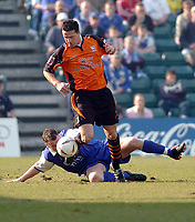 Photo. Leigh Quinnell.  Gillingham v Ipswich Town Coca Cola championship. 24/01/2005. Gillinghams Michael flynn tackles Tommy Miller for Ipswich.
