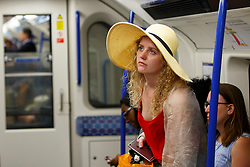 © Licensed to London News Pictures. 19/07/2016. London, UK. People commute on the tube in London on the UK's hottest day of the year so far on Tuesday, 19 July 2016. Photo credit: Tolga Akmen/LNP