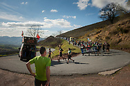 """People run on the 20th Korrika down Izpegi mountain port. Erratzu (Basque Country) April 3, 2017. The """"Korrika"""" is a relay course, with a wooden baton that passes from hand to hand without interruption, organised every two years in a bid to promote the basque language. The Korrika runs over 11 days and 10 nights, crossing many Basque villages and cities, totalling some 2300 kilometres. Some people consider it an honour to carry the baton with the symbol of the Basques, """"buying"""" kilometres to support Basque language teaching. (Gari Garaialde / Bostok Photo)"""