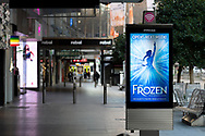 """A sign promotes the opening of the Musical """"Frozen"""" next week in the Bourke Street Mall as the state waits to see if the lockdown will be extended as it enters 6th day of the state wide COVID-19 snap lockdown that has been placed on the State of Victoria.  (Photo by Michael Currie/Speed Media)"""