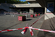 As the number of new Coronavirus cases in the UK climbs to 201,101, with UK deaths now standing at 30,076 - the highest recorded in Europe, <br /> hazard tape stretches across a normally busy plaza outside the National Theatre remains closed to the public, during the continuing Covid lockdown, on 6th May 2020, in south London, England.