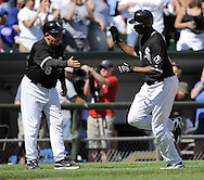 CHICAGO - JUNE 28:  Jermaine Dye #23 is greeted by third base coach Jeff Cox #8 of the Chicago White Sox after hitting a home run in the eighth inning against the Chicago Cubs on June 28, 2009 at U.S. Cellular Field in Chicago, Illinois.  The White Sox defeated the Cubs 6-0.  (Photo by Ron Vesely)