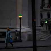 A woman walks past The New York Stock Exchange (NYSE) in New York, U.S., on Thursday, Dec. 27, 2018. U.S. Photographer: John Taggart/Bloomberg