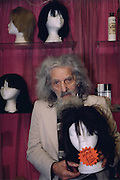 At Edgeware road in central London the owner of a wig shop holds a manniquins head with human hair.  The most expensive wigs are Indian temple hair wigs, these can fetch several hundred pounds.