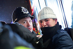 © under license to London News Pictures. A protestor after scuffles with the police as the Save EMA (Educational Maintenance Allowance) protest breaks up in Victoria St, London outside the Department for Innovation and Skills (13/12/10) Photo credit should read: Olivia Harris/ London News Pictures