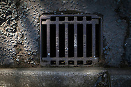 Maintenance Hole- and Drain Covers of Wirral by Colin McPherson, 2020-21.<br /> <br /> A modern replacement gully cover, installed after the time of local government reorganisation in the 1970s handed control of roads from four local authorities to Wirral Metropolitan Borough.