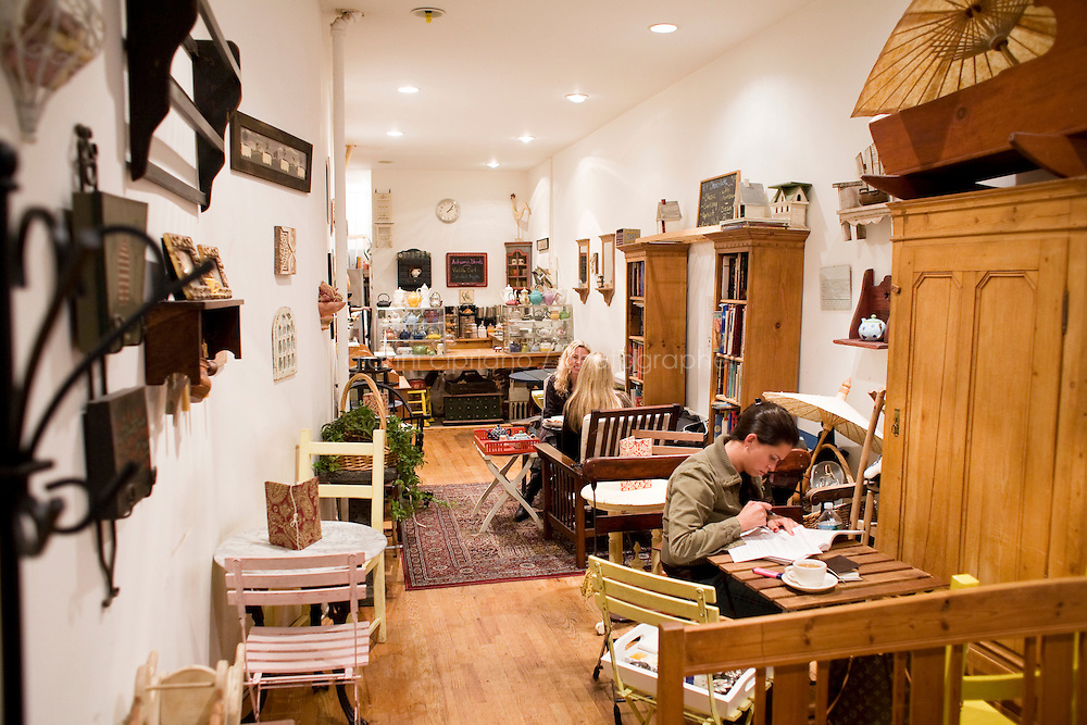 """5 November, 2008. New York, NY. Customers have tea and relax at the Podunk, a self-styled """"American tearoom"""" in the East Village.The owner, Elspeth Treadwell, left a career in publishing to open Podunk six years ago, in 2002. <br /> <br /> ©2008 Gianni Cipriano for The New York Times<br /> cell. +1 646 465 2168 (USA)<br /> cell. +1 328 567 7923 (Italy)<br /> gianni@giannicipriano.com<br /> www.giannicipriano.com"""
