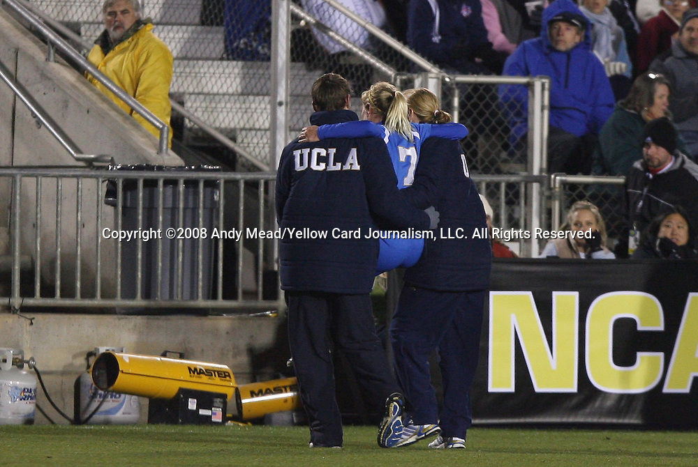 05 December 2008: UCLA's McCall Zerboni (7) is carried off the field by head coach Jillian Ellis (right) and another member of the UCLA staff after suffering a game-ending injury. The University of North Carolina Tar Heels defeated the University of California Los Angeles Bruins 1-0 at WakeMed Soccer Park in Cary, NC in an NCAA Division I Women's College Cup semifinal game.