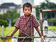 03 NOVEMBER 2015 - YANGON, MYANMAR: A boy in downtown Yangon listens to speakers at a Democratic Party Myanmar campaign rally. The Democratic Party of Myanmar was established in the wake of the 1988 protests and contested the 2010 elections. The party is running candidates in several races for the Myanmar legislature.        PHOTO BY JACK KURTZ