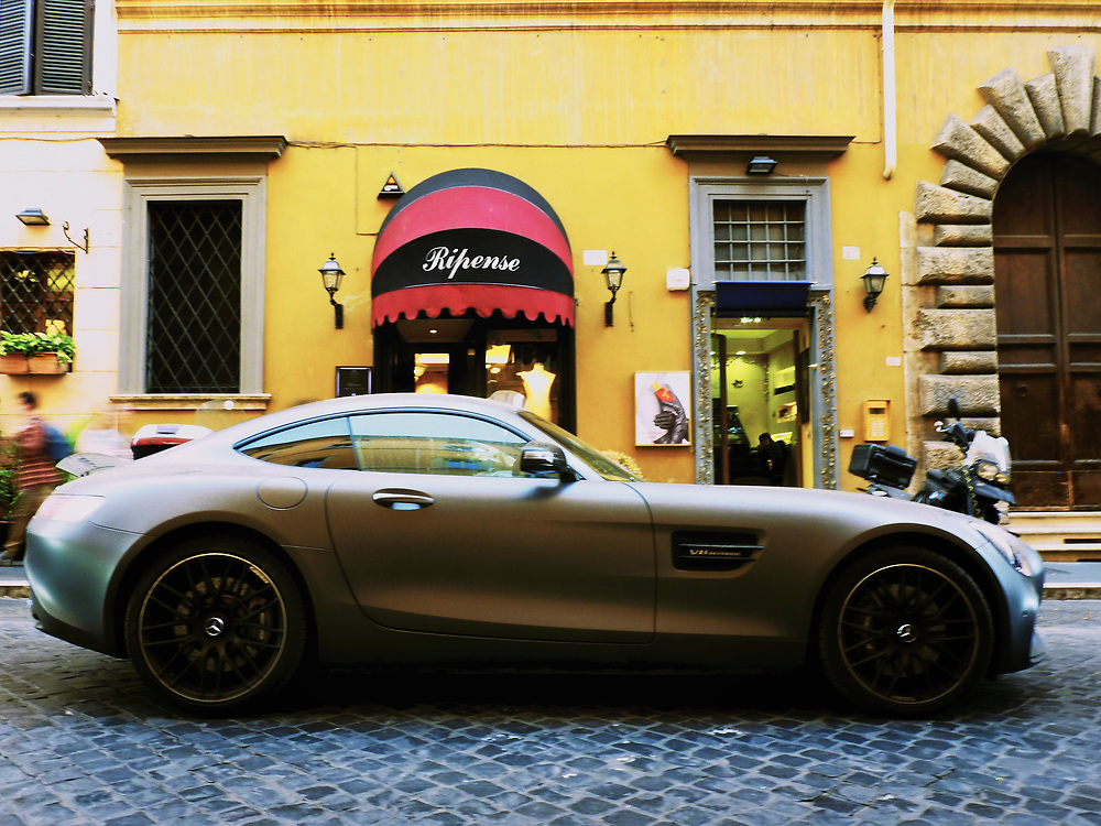 This Mercedes Benz 300SL Coupe was parked in front of the owner's restaurant in Rome.  Unlike every other sample of this model I'd seen before, this one was dirty and looked as if it was driven daily and not babied in the garage.