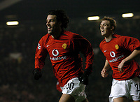 RUUD VAN NISTELROOY MAN UTD CEDLEBRATES SCORING 1ST GOAL WHICH EQUALS DENNIS LAW'S RECORD OF 28 IN EUROPE FOR MANCHETER UNITED<br /> MANCHESTER UNITED V VFB STUTTGART 09/12/03 CHAMPIONS LEAGUE <br /> PHOTO ROBIN PARKER DIGITALSPORT