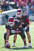 Oct 27, 2012; Little Rock, AR, USA; Arkansas Razorback center Travis Swanson (64) and quarterback Tyler Wilson (8) prepare for a play during a game against the Ole Miss Rebels at War Memorial Stadium. Ole Miss defeated Arkansas 30-27. Mandatory Credit: Beth Hall-US PRESSWIRE