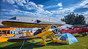 Waco Biplane and camp in front of the WAAAM Hangar at the Hood River Fly In at Western Antique Aeroplane and Automobile Museum