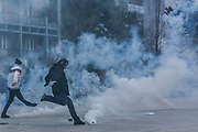 Jan. 27, 2015 - Prishtina, Kosovo - Police clash with a crowd of protesters who rallied in Kosovo, to call for the dismissal of a Serb minister they accuse of insulting Albanian war victims. Tear gas was deployed to disperse the rally. (Credit Image: © Vedat Xhymshiti/ZUMA Wire)