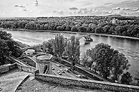 Black and white view of the St. Bènezet Bridge with lle de la Barthelasse in the foreground, Avignon, France.