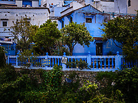 CHEFCHAOUEN, MOROCCO - CIRCA MAY 2018: Typical street of Chefchaouen in Morocco.