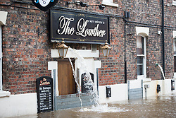 © Licensed to London News Pictures. 07/12/2015. York UK. Picture shows the Loather pub in York, the city has flooded for the second time this month after the river Ouse burst it banks last night with the after effects of Storm Desmond. Photo credit: Andrew McCaren/LNP