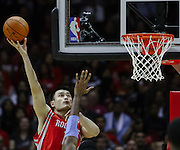 Oct 30, 2010; Houston, TX, USA; Houston Rockets center Yao Ming (11) shoots against the Denver Nuggets during the first quarter at the Toyota Center. Mandatory Credit: Thomas Campbell-US PRESSWIRE