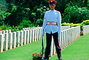 Soldier standing on guard over Commonwealth war graves at Krangi War Cemetery in Singapore