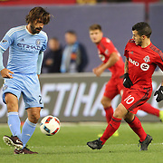 NEW YORK, NEW YORK - November 06:  Andrea Pirlo #21 of New York City FC is challenged by Sebastian Giovinco #10 of Toronto FC in action during the NYCFC Vs Toronto FC MLS playoff game at Yankee Stadium on November 06, 2016 in New York City. (Photo by Tim Clayton/Corbis via Getty Images)