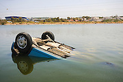 A car driven by a drunken driver, overturned into a pond