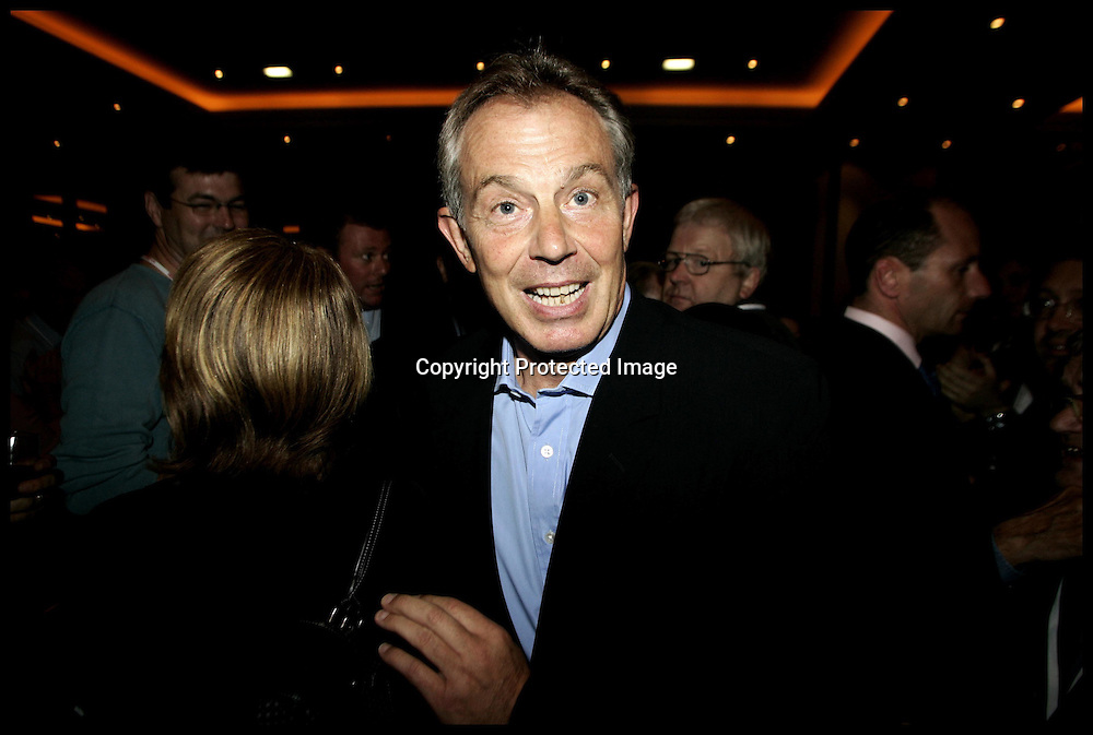 Prime Minister Tony Blair is greeted by Labour Supporters as he attends a reception at the Labour Hotel  in Manchester for the start of the Labour Party Conference which is due to start tomorrow.PRESS ASSOCIATION Photo. Picture date:Saturday 23rd September  , 2006. Photo credit should read: Andrew Parsons/PA. POOL