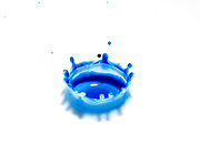 Ink droplet impact, High-speed photographic technique showing coronet, which forms after a droplet hits the surface of a liquid. The displaced water is pushed up into this crown- shaped structure for a fraction of a second, splash