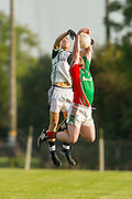 Longwood vs St Marys, A football league division 4 final at Bective GFC, 13/09/14<br /> Nathan O`Neill (Longwood) & Conor Lenihan (St Marys)<br /> Photo: David Mullen / www.cyberimages.net © 2014