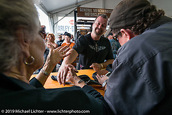The Davidson Family (Nancy and Bill) sign autographs on Wednesday during the Ride-In Show at the Harley-Davidson display during Daytona Bike Week. FL, USA. March 12, 2014.  Photography ©2014 Michael Lichter.
